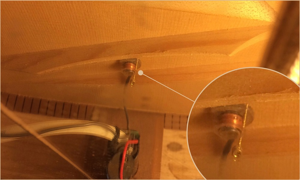 String ends left inside an acoustic guitar can become magnetically attached to some pickups like this Taylor body sensor