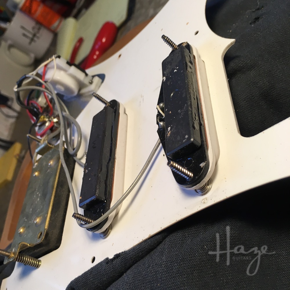 Reattaching the bar magnets restored the output of these pickups. Fixed.