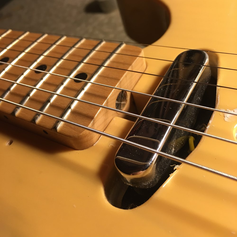 If you're lucky, you'll have a channel under your Telecaster pickguard to allow access to the truss rod