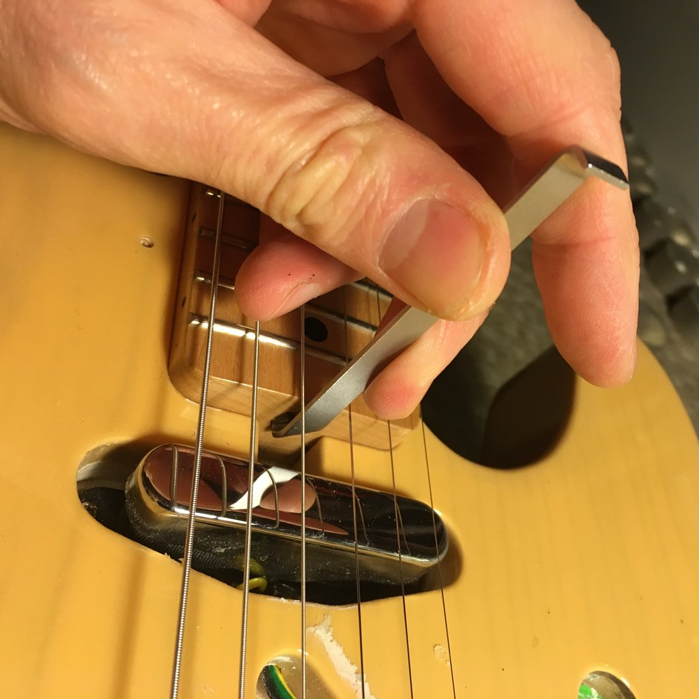 An offset screwdriver should make adjusting the truss rod on this Tele much easier.