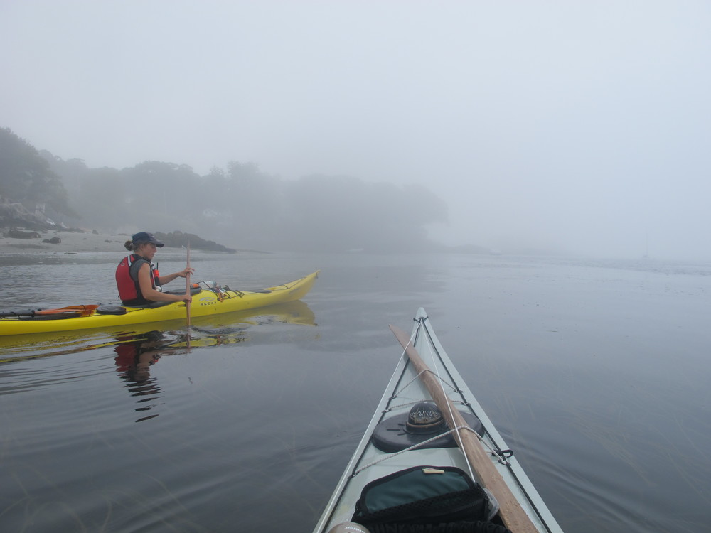 Rounding Brackett Point on the south side of Peaks Island (Pictured: Erin Quigley, Portland Paddle guide, Photo: Joe Guglielmetti)
