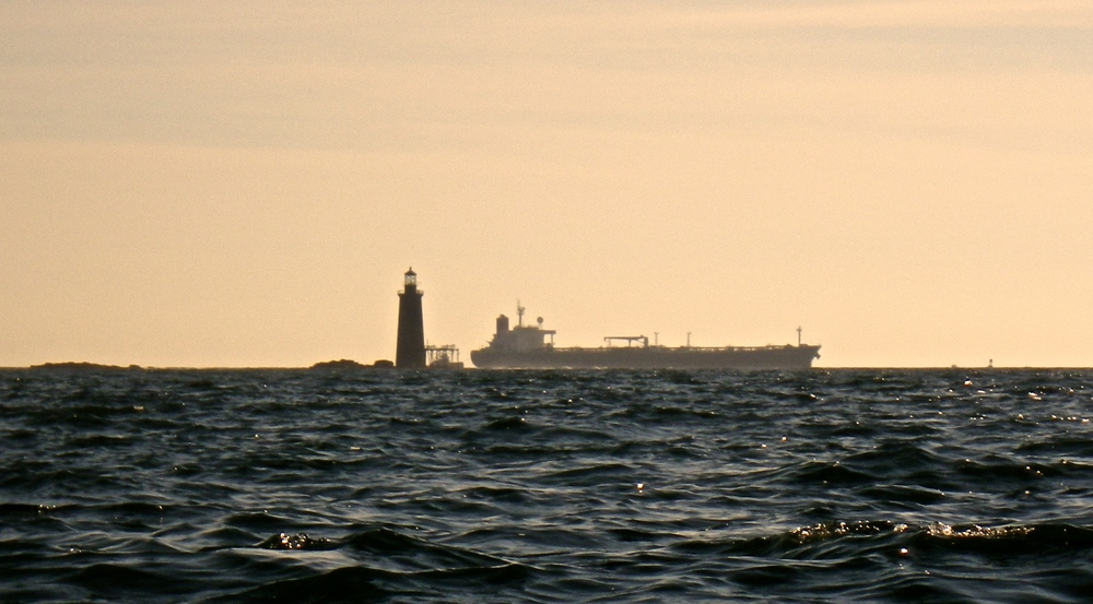 A crude oil tanker passes behind Ram Island Ledge Lighthouse (Photo: Joe Guglielmetti)