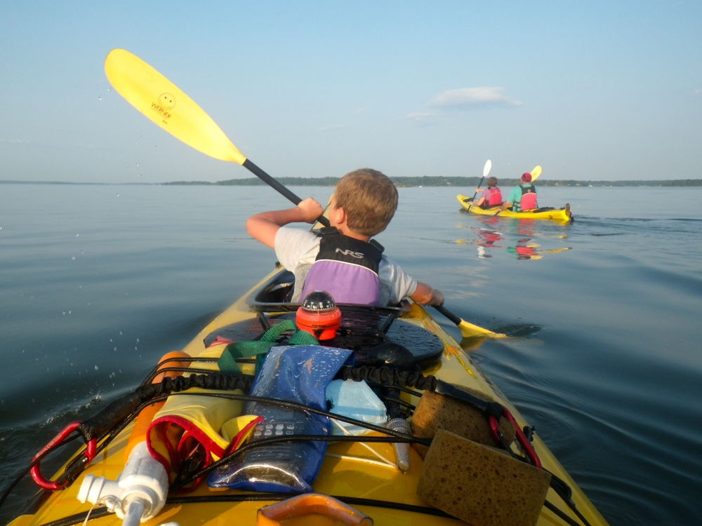 kid in tandem kayak