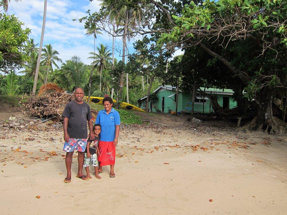 6  Ratu, Tony, and Aliti, their house behind.jpg