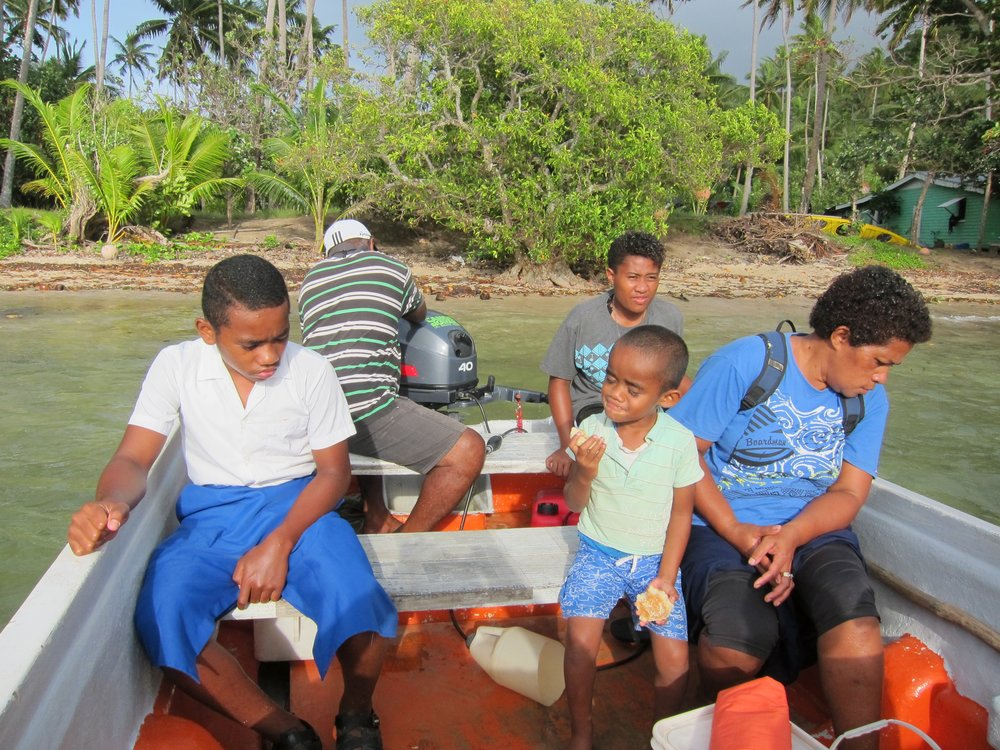 98  Left to right Tumbai, Ratu, Lucy, Tony, and Aliti in the boat.jpg