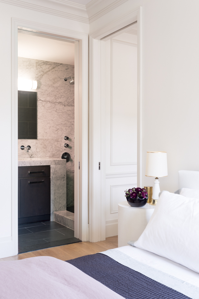 Pocket doors in the master bedroom save precious floor space.