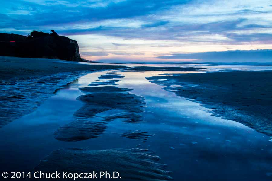Sunset after a day of rain on Pomponio State Beach near Santa Cruz, California.