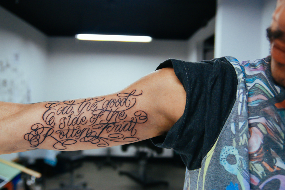 cesar-inner-arm-tattoo.jpg
