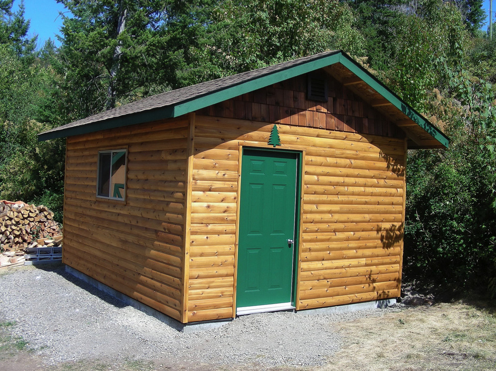 "Storage shed constructed with RB 5/4x6"" log siding"