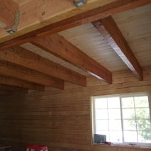 "Interior. RB 6x8"" Pine log walls with RB Fir timbers"