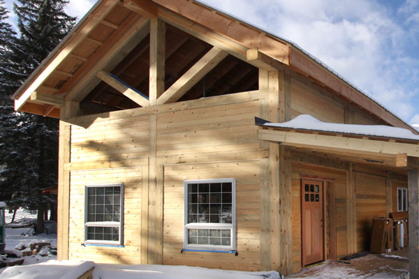 Logs log siding rouck bros log homes for Square log cabin