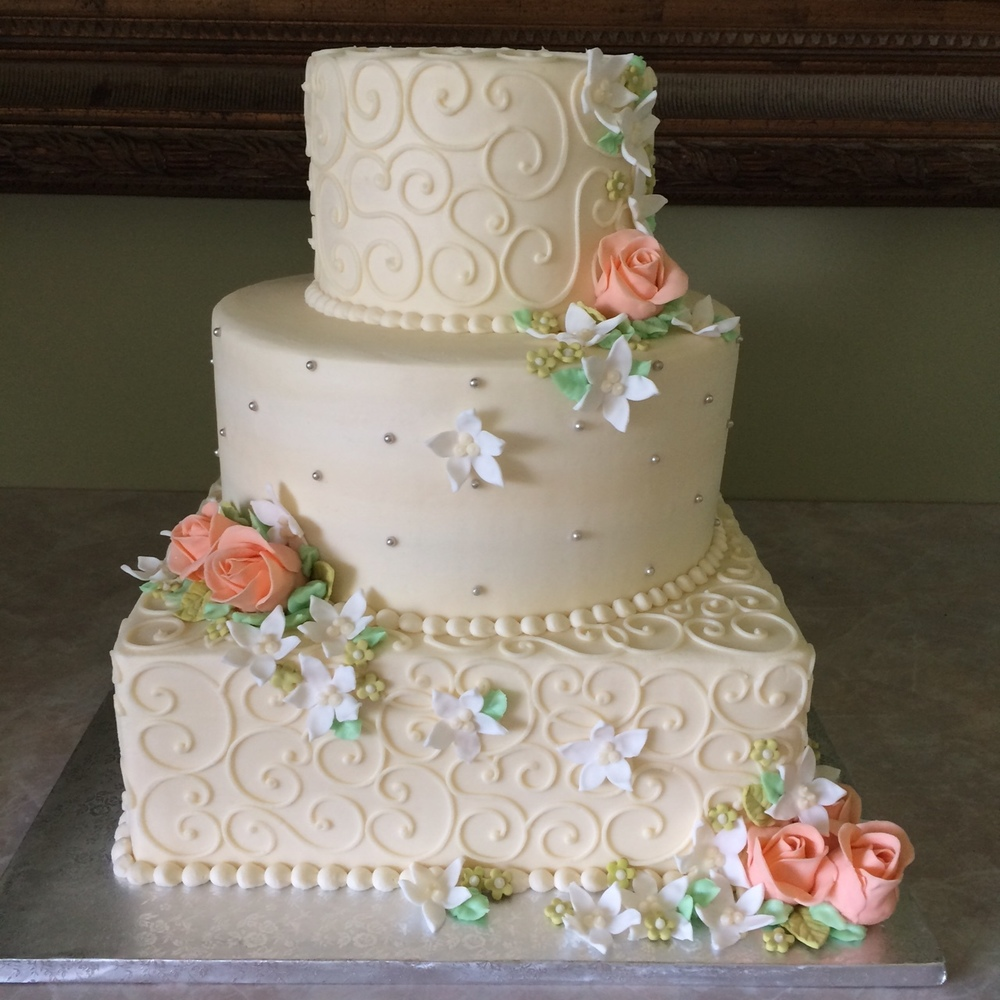 Peach Roses with Stephanotis Wedding Cake