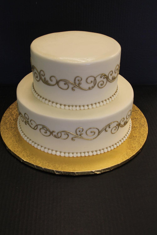 Golden Scrollwork Wedding Cake