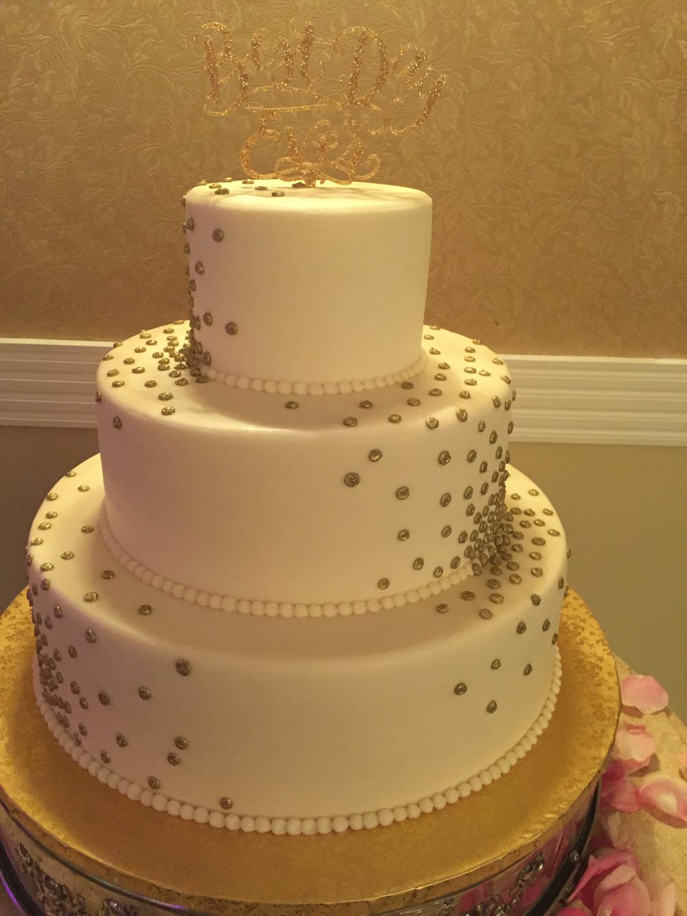 Gold Dots on A Three Tier Wedding Cake