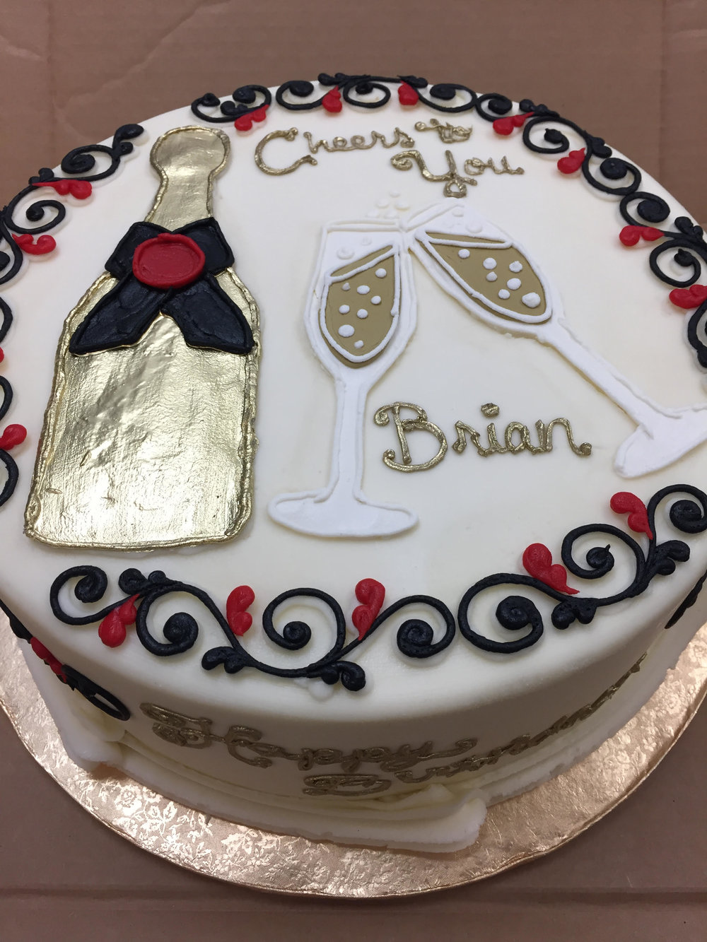 A Bottle and Two Glasses Birthday Cake