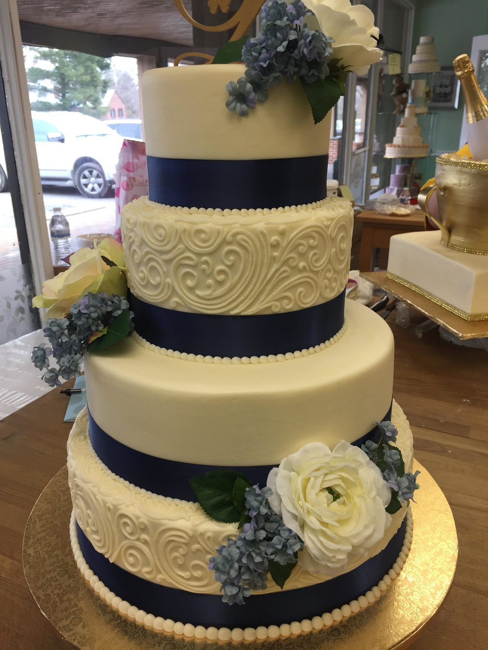 Four Tier Blue Ribbon and Flowers Wedding Cake