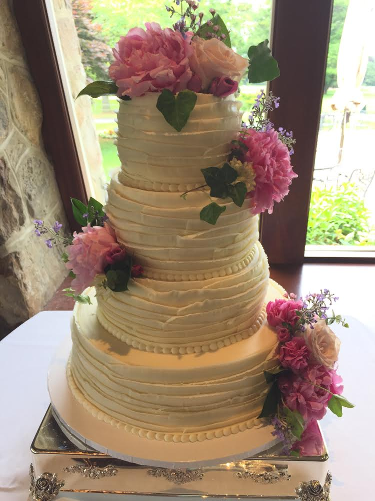 Ruffled Icing and Flowers Wedding Cake