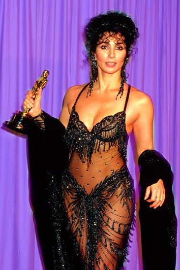 Cher, holding her Oscar for  Burlesque
