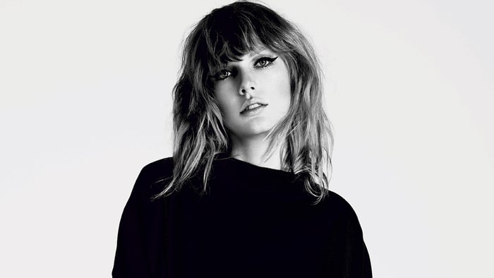 taylor-swift-press-photo-acb2c4fc-c884-4ec2-b889-6ea529cbcff4.jpg