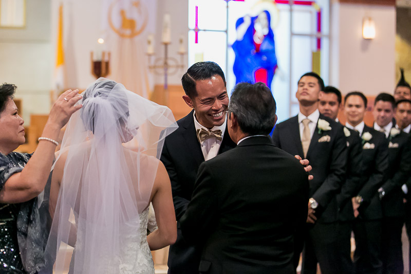Groom receiving bride from her father
