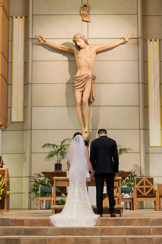 bride and groom at wedding altar at St Paul the Apostle Catholic Church
