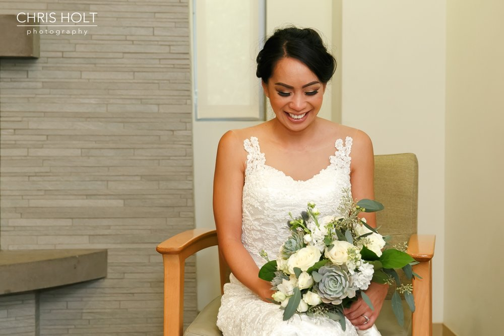 bride with bouquet before her ceremony