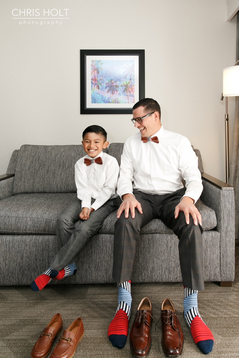 groom and son putting their shoes on