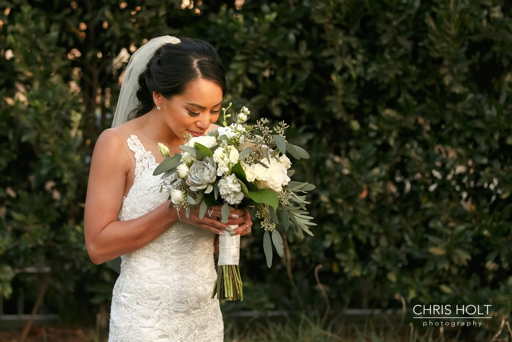 bride smelling her beautiful bouquet