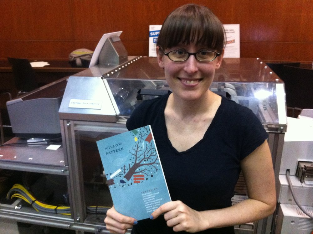 Bronwen Blaney with the very first copy of  W  illow Pattern , fresh from the Espresso Book Machine in Brooklyn, June 2012