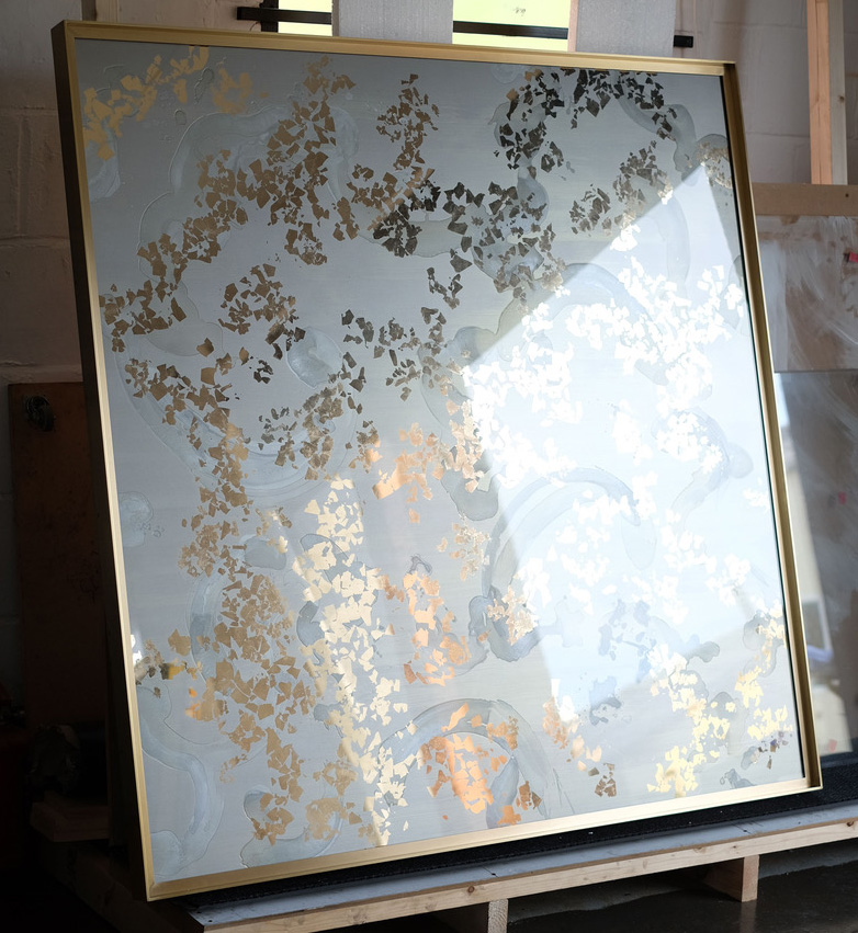 A pair of 1.5 metre square gold and silver verre églomisé mirrors with satin brass frames,for a private residence
