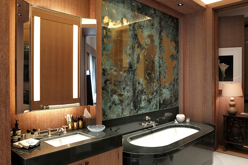 Large mirrored panels, enveloped by copper verdigris surrounds, created with 22 carat gold leaf and real chemically aged copper leaf for a London private residence.