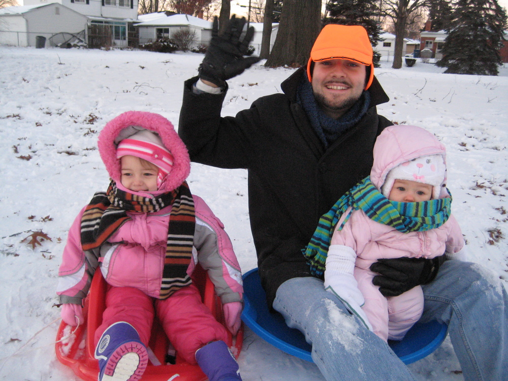 The first official Mason Family Sledding Trip. (hand warmers + socks = great baby mittens)