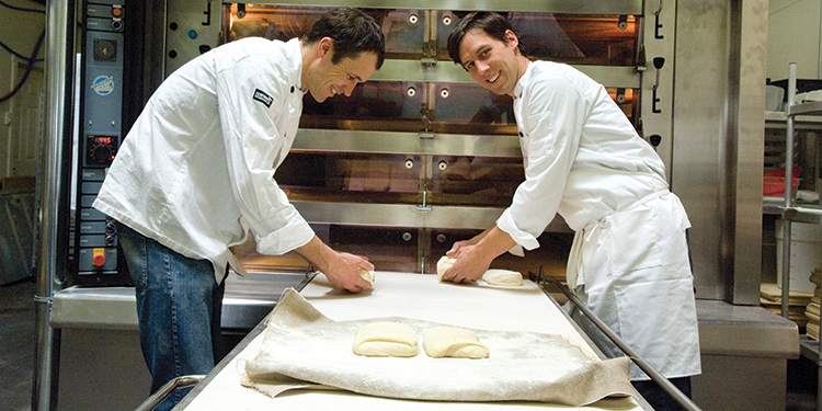 Ty Mack and Jerod Pfeffer of 460° Bread prepare their artisanal loaves for baking.