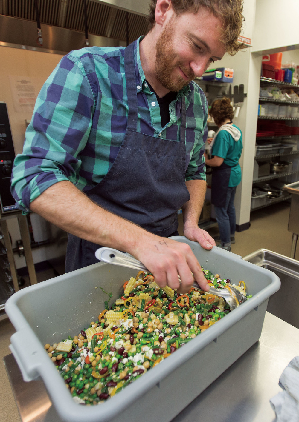 Chas Baki, a chef at Gather, prepares a bean salad for students at theJackson Hole Classical Academy.