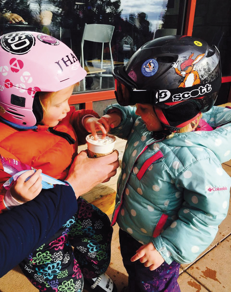 Zoe and Ivy enjoy après ski with hot chocolate, friends, and stylish ski outfits.