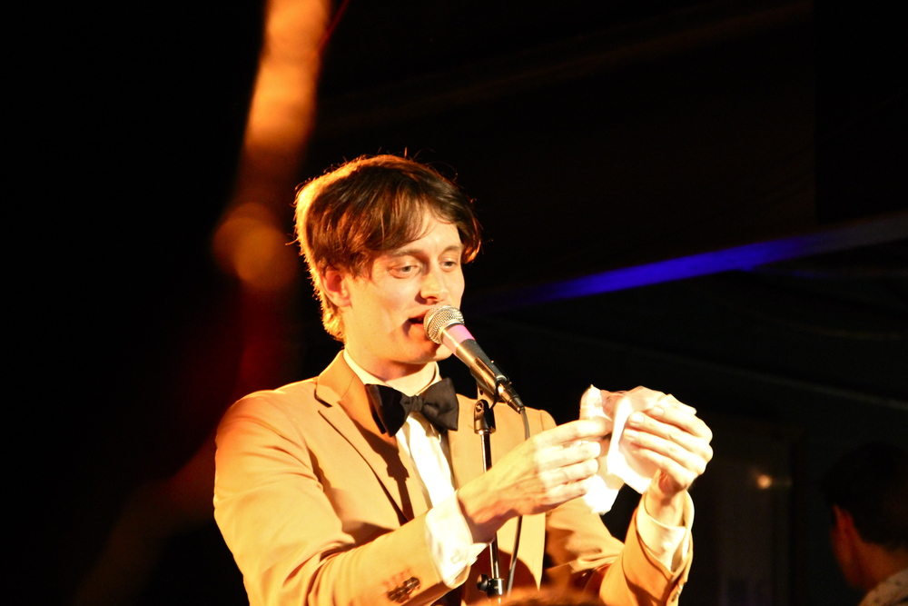 Casper Clausen of Efterklang reads letters to Denton from their previous show. - photo by Courtney Marie