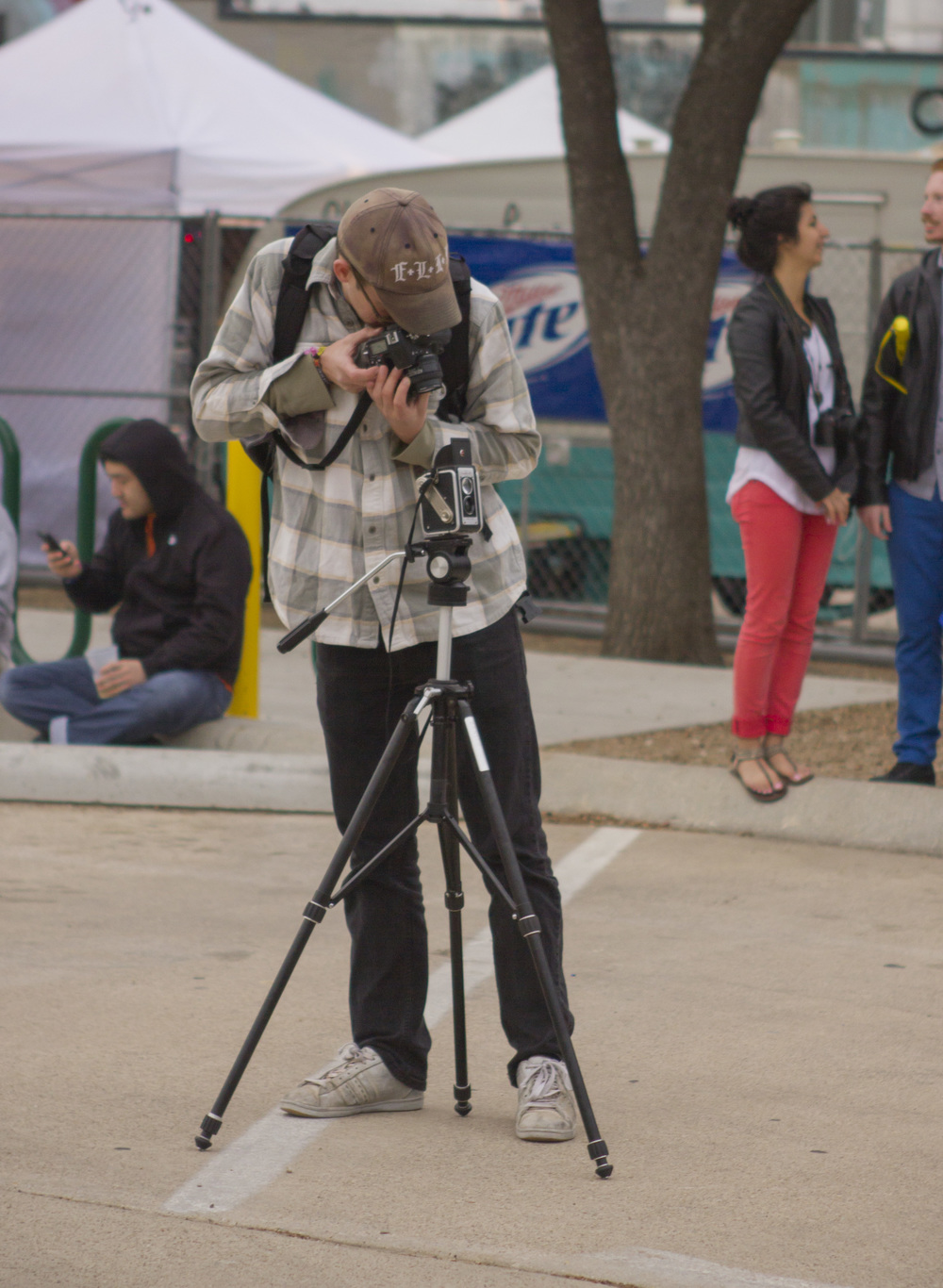 A photographer takes a digital shot of an analog camera at 35 Denton in March.