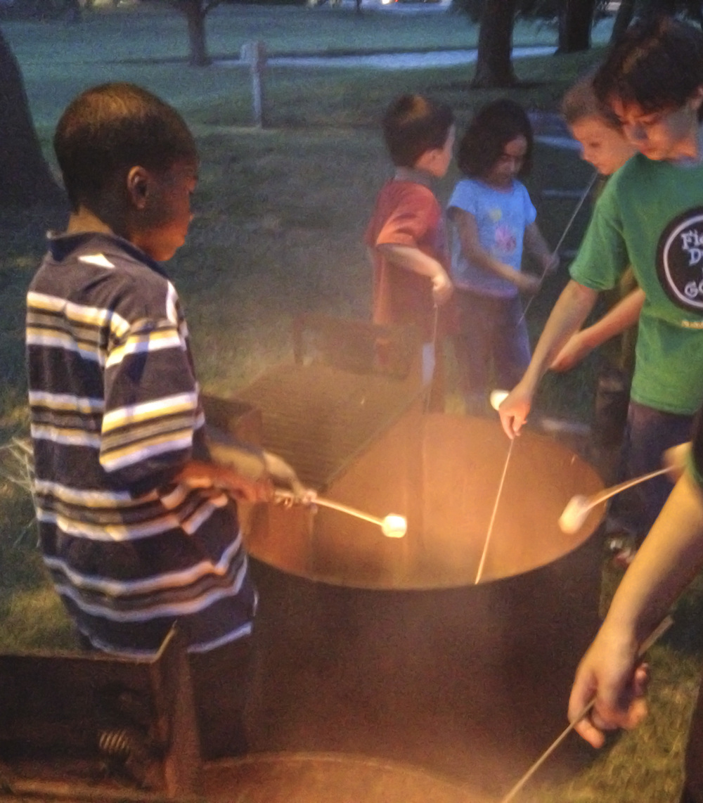 Children in Denton roasted marshmallows and danced before the start of  Puss in Boots  last week at Movie in the Park.