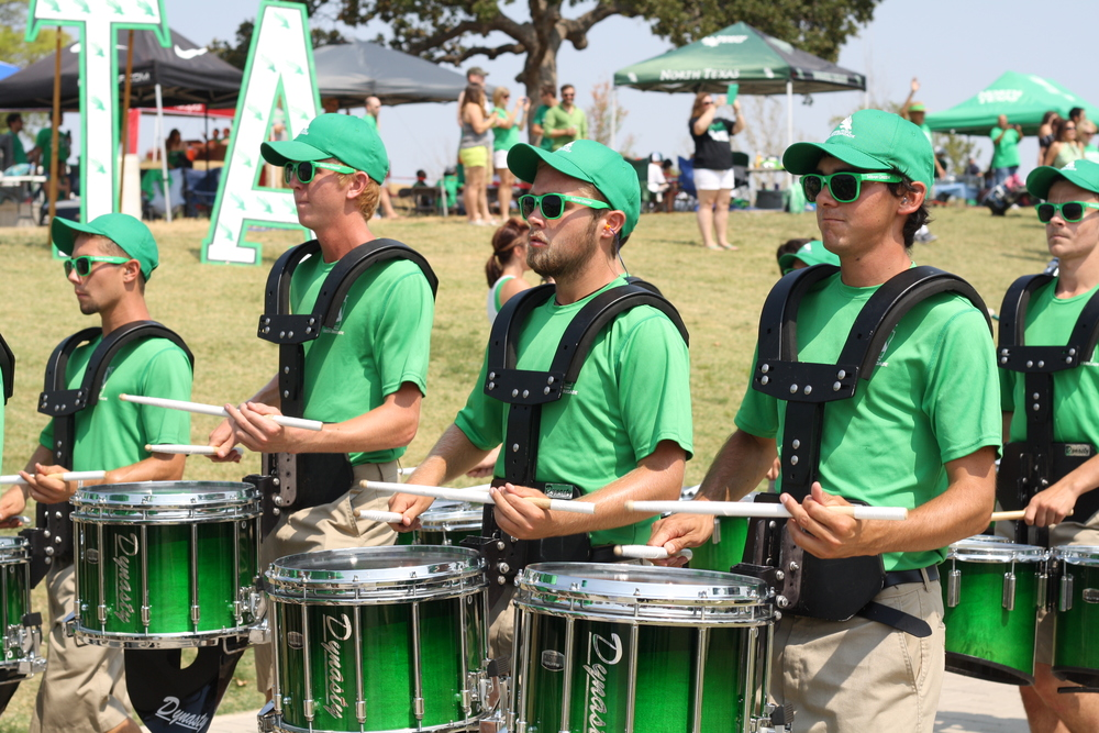 Tailgating includes the Mean Green marching band making their way through the crowds and into the stadium.