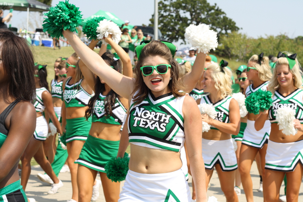 We found some spirit deep within us and cheered on the UNT football team on Saturday. Thankfully we were there to witness their victory over Ball State. We even got spotted dancing on the big screen.