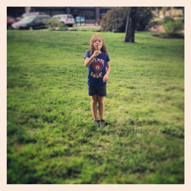 Blowing dandelions on the square after the requisite Saturday morning jam. Photo by Instagram user jnemergut.