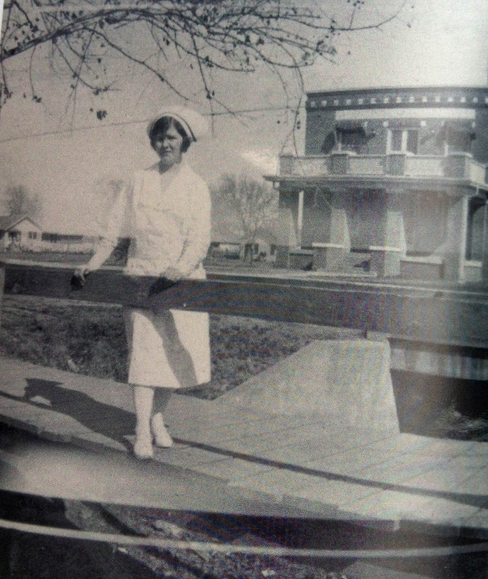 An unidentified nurse outside of the old Denton City Hospital south of the square, which has it's own ghostly stories.