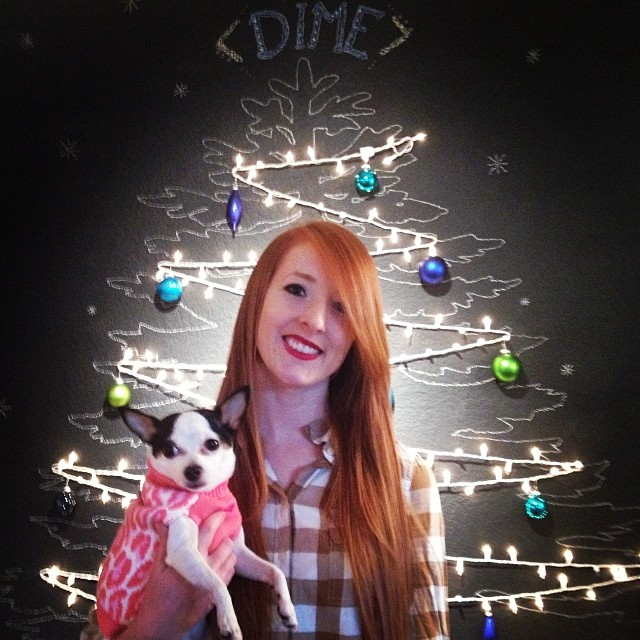 Here's  @Natalieohhhh  in front of The DIME Store's Christmas chalk Christmas tree. Photo by  Bryce Olcon.