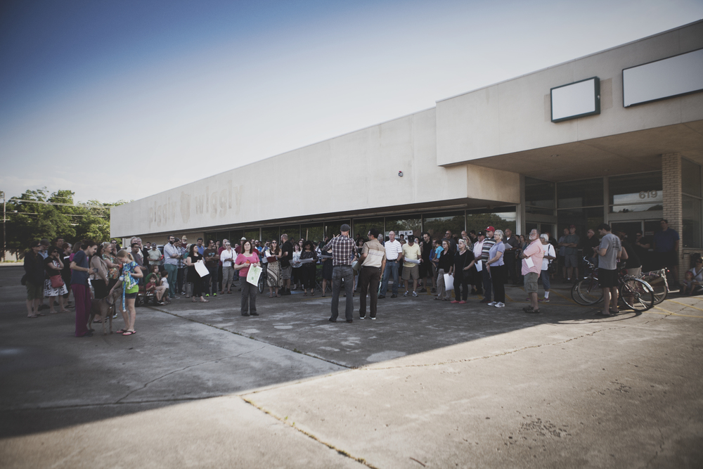 A large crowd gathered outside of the long-closed Piggly Wiggly yesterday evening to discuss Better Block Denton.