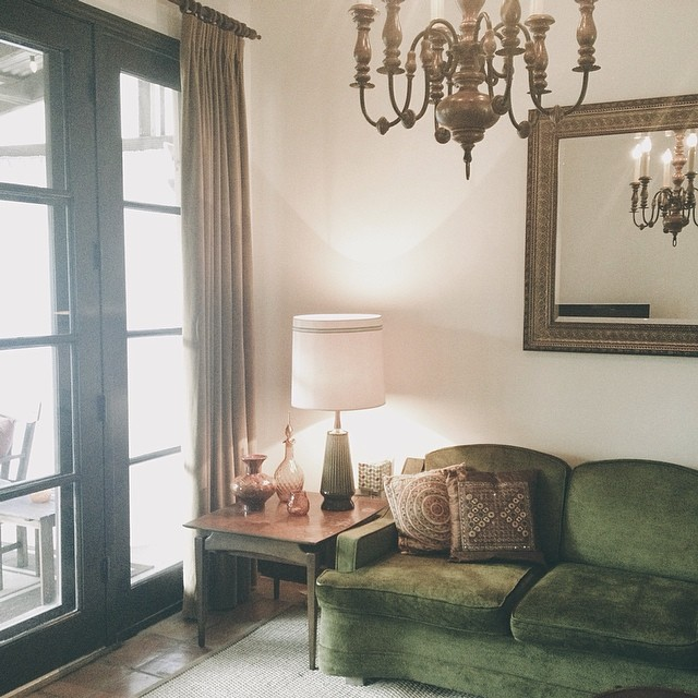 A comfy green couch in a beautiful home - spotted by @jadewintersee.