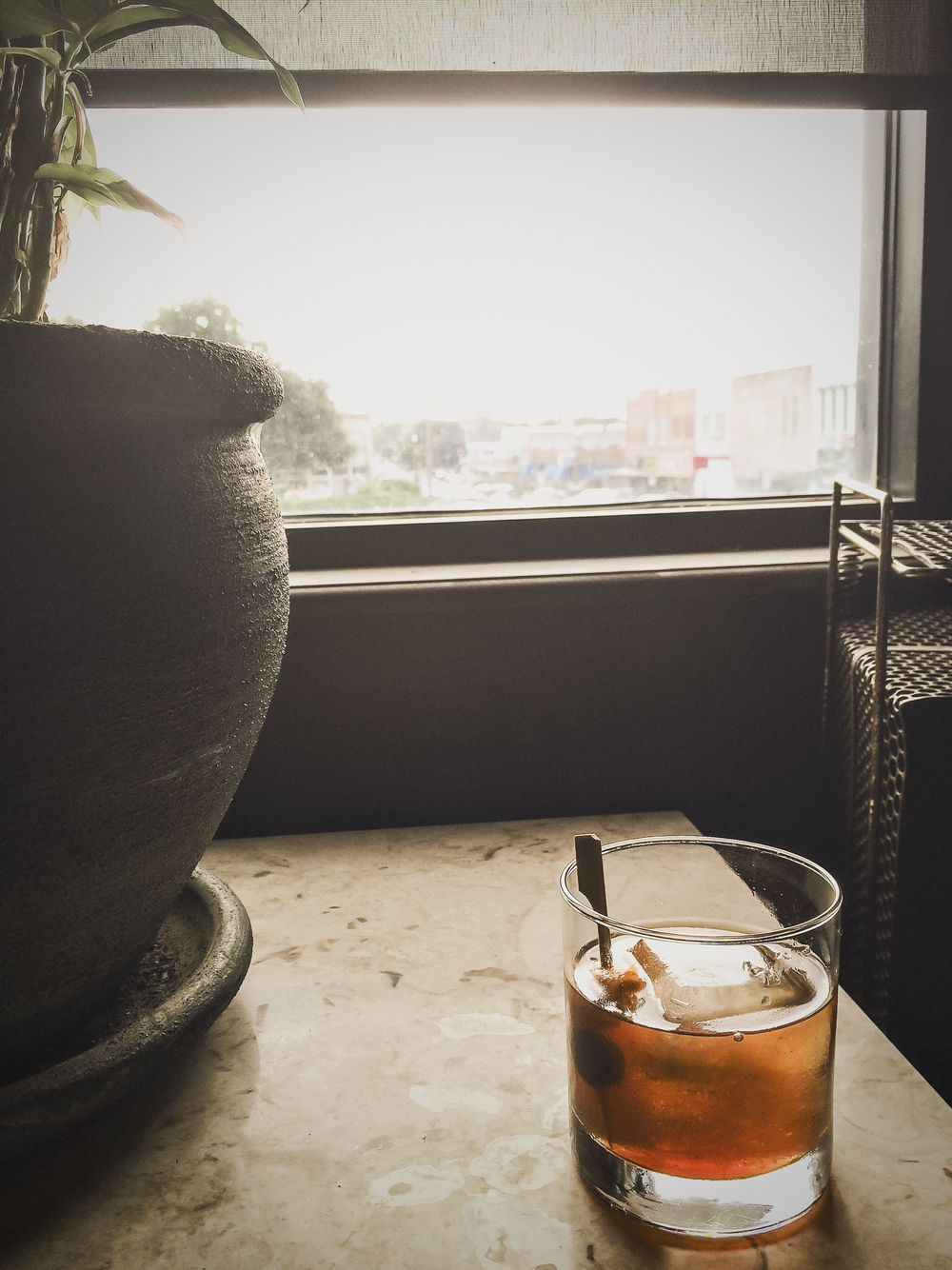 A little rain may move us inside, but when the inside gives you bourbon and a great view that ain't such a bad thing.