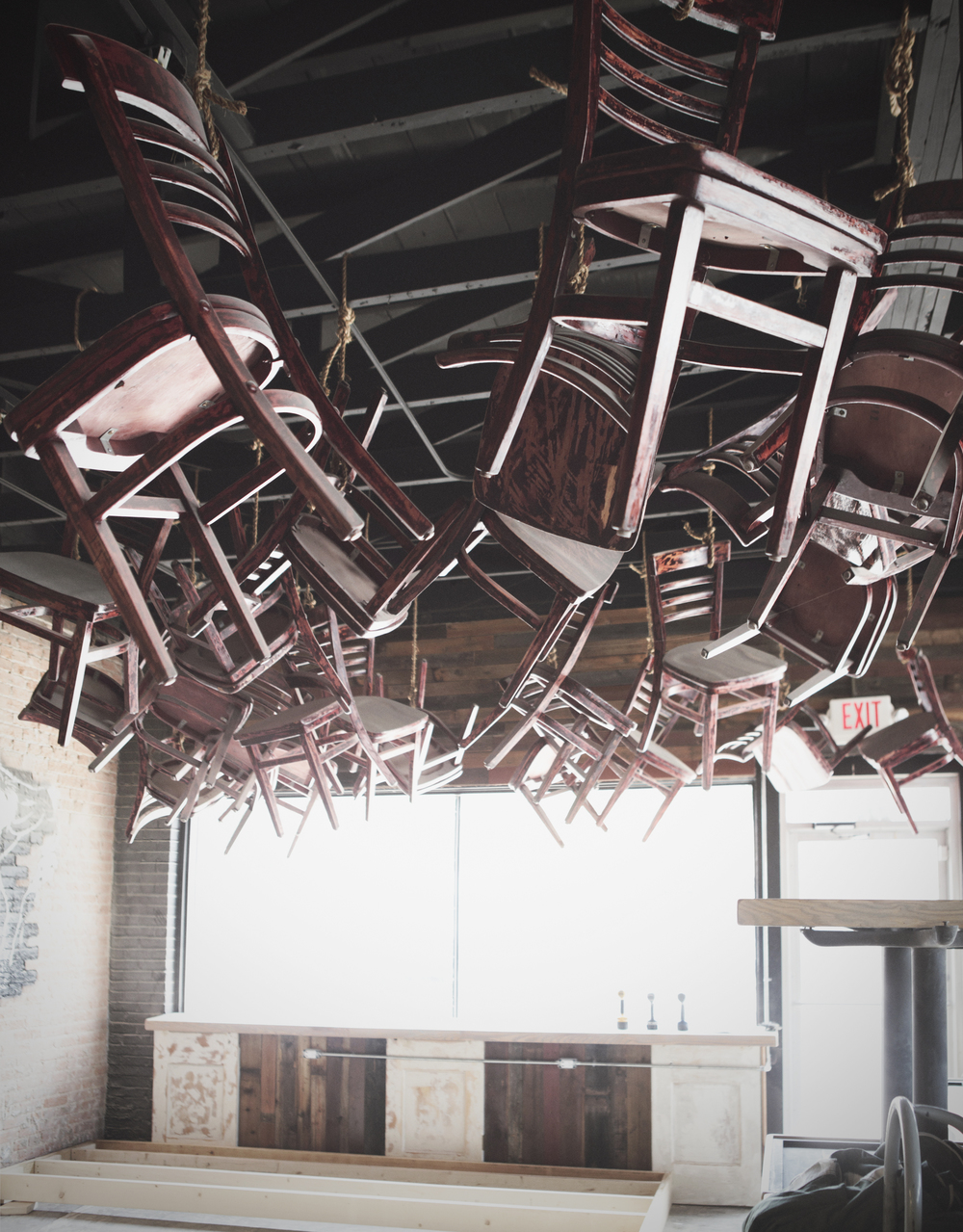 Chairs from Burguesa are strung up on the ceiling.