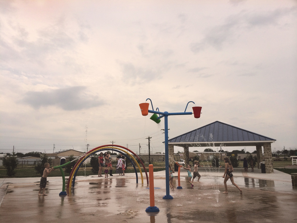Sanger (a small town about ten minutes north of Denton) just recently had a free splash park installed. We went on one of last week's less rainy days and scoped the place out.