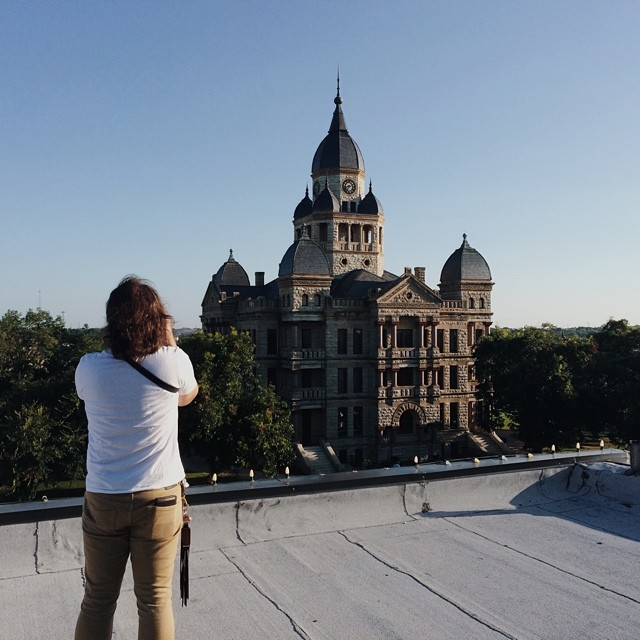 @Lynzi et co. spying the courthouse from the rooftop of what looks to be the Texas Building.