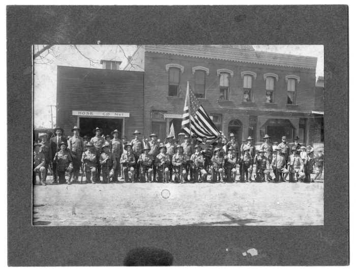 A 1914 group photo of World War I   soldiers   in front of the fire station on West Oak Street.